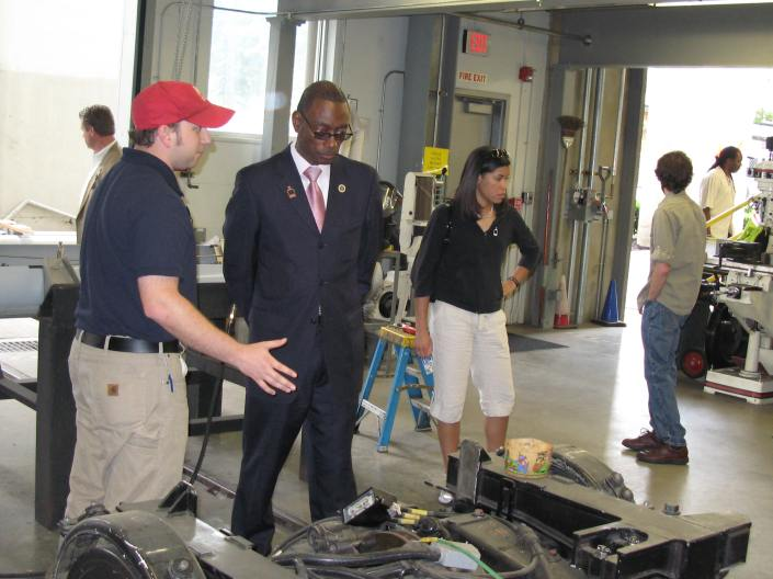 Mayor Mallory at a Streetcar Maintenance Facility in Portland. Note the Lapel Pin.