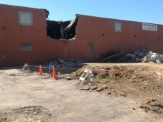 Demolition has begun on the second building (1910 Elm St., east building).