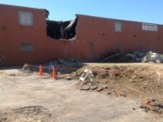 Demolition has begun on the second building (1910 Elm St., east building).