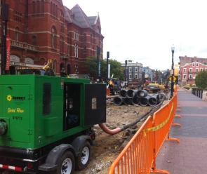 Giant green pump for the temporary sewage line.
