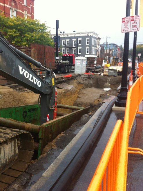 Crews repair a ruptured sewer line at 14th and Elm Street, as part of  the streetcar construction contract.